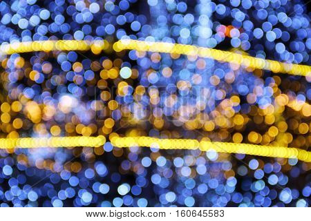 Abstract bokeh background with holiday decoration sparkles