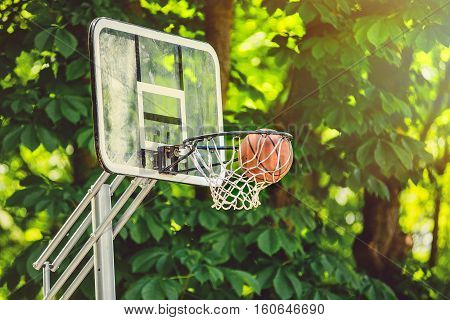 Basketball basket with all going through net. Basketballs hit the basket