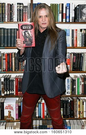 HUNTINGTON, NY-DEC 5: Singer Sebastian Bach signs copies of his book '18 And Life On Skid Row' at Book Revue on December 5, 2016 in Huntington, New York.