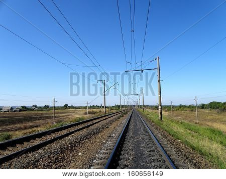 Double-track electrified railroad goes into the distance.