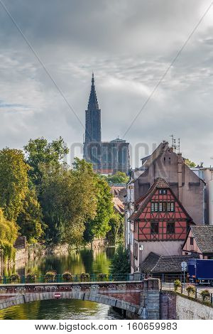 View of medieval bridge Ponts Couverts and Strasbourg Cathedral from the Barrage Vauban in Strasbourg France