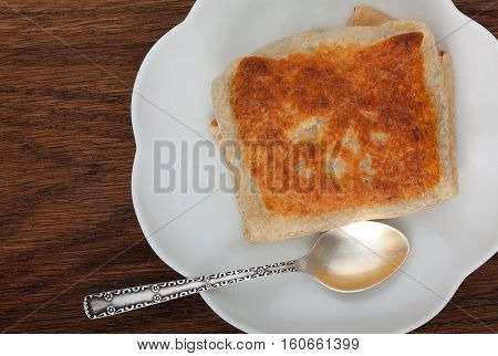 Stuffed Pancake With Meat Stuff On A Little White Plate With Vintage Teaspoon On A Old Dark Wooden B