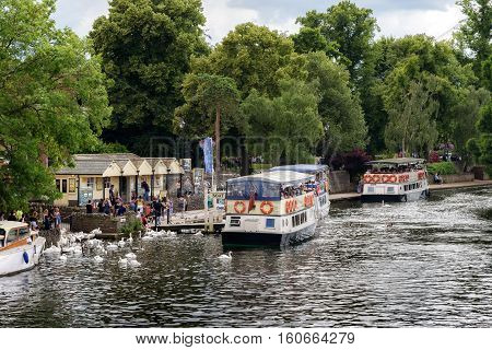 Cruise boats along the most picturesque part of the Thames at Windsor Surrey England.