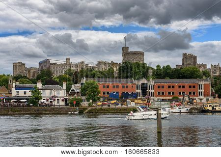 The skyline of Windsor Town across river Thames in Berkshire county England.