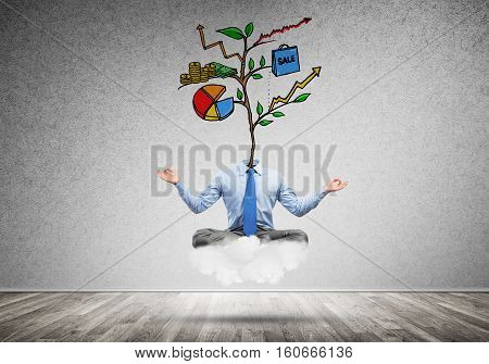 Businessman in lotus pose with lamp head meditating on cloud