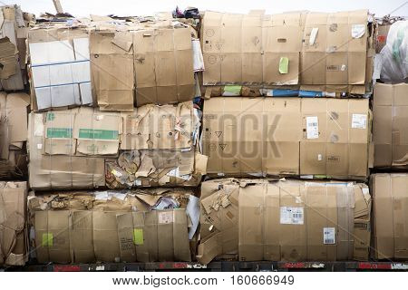 bales of paper and plastic wrapped ready to recycle