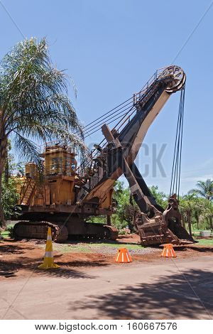 Excavator in front of the entrance of the former iron mines in Thabazimbi, Limpopo, South Africa