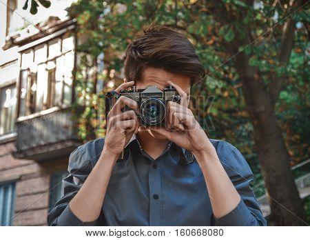 Hipster photographer with retro film photo camera
