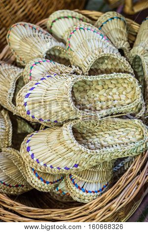 handmade braided sandals in the wickerwork hamper at the exhibition