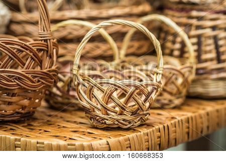 handmade wicker basket on the wicker table at the exhibition