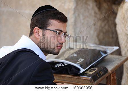 Jerusalem, Israel - November 2 , 2016: Orthodox Jewish Man at the Western Wall in Jerusalem, Judaism's holiest site. Israel