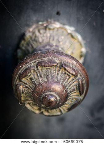 Old decorative metal door handle with ornaments in Bairro Alto Lisbon Portugal