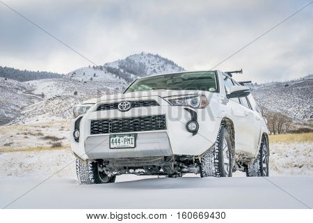 FORT COLLINS, CO, USA - DECEMBER 7, 2016:  Toyota 4Runner SUV (2016 Trail edition)  visiting Lory State Park with a fresh snow.