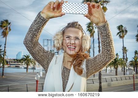 Fashion-monger In Barcelona, Spain Taking Photo With Smartphone