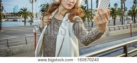 Tourist Woman In Barcelona, Spain Taking Photo With Phone
