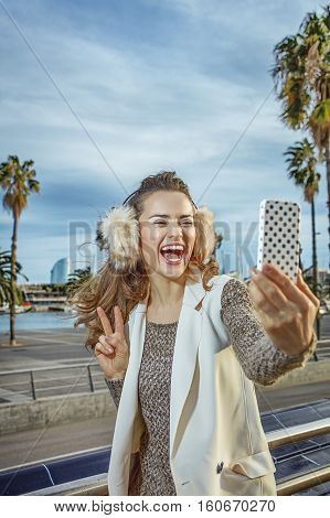 Happy Woman In Barcelona, Spain Taking Selfie With Smartphone