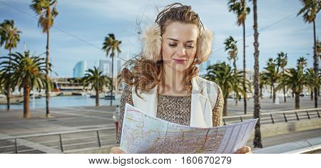 Happy Woman On Embankment In Barcelona, Spain Looking At Map
