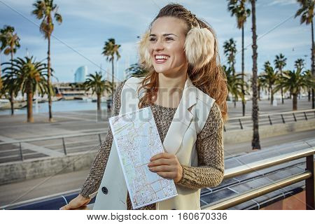Smiling Tourist Woman In Barcelona, Spain Having Excursion