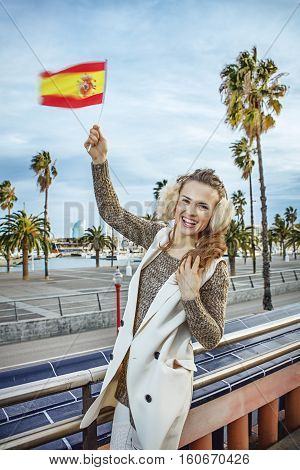 Happy Young Fashion-monger In Barcelona, Spain Rising Flag