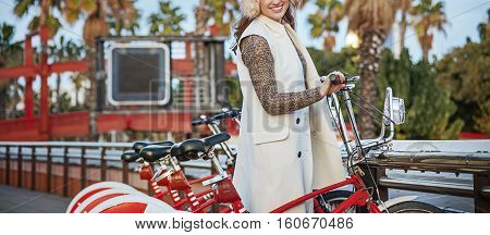 Happy Fashion-monger In Barcelona, Spain Standing Near Bicycle