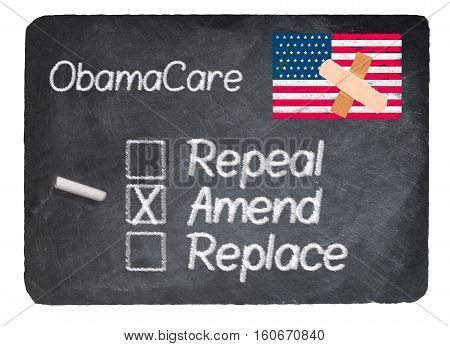 Obamacare health plan choice for amend written in chalk on a chalky natural slate blackboard isolated against white background