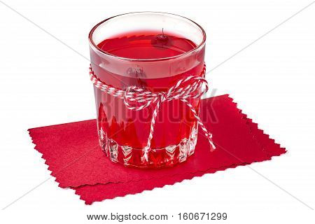 Glass of cranberry fruit drink on red paper napkin. Isolated on white background.