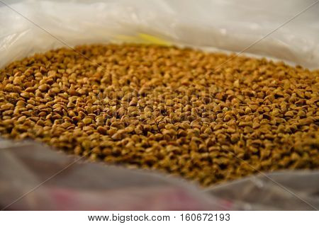 Background of the raw buckwheat in the cellophane bag