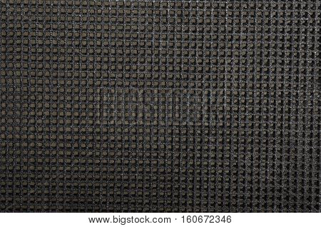 Close up of black textured synthetical grid background