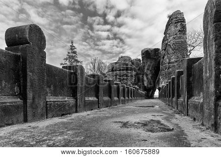 The Bastei Bridge old stone footbridge. Major landmark of the Saxon Switzerland National Park Germany. Black and white image