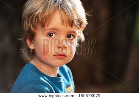 Portrait of boy. close up. looking at camera. cute boy