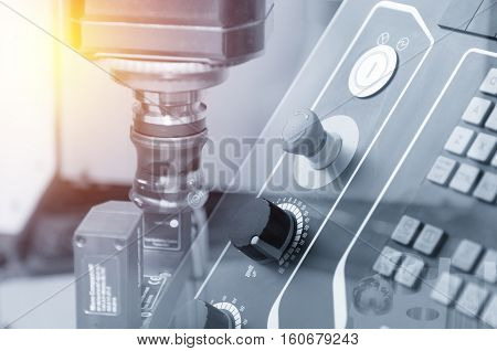 The abstract scene of the CNC controller panel and index-able cutting tool with the lighting effect.