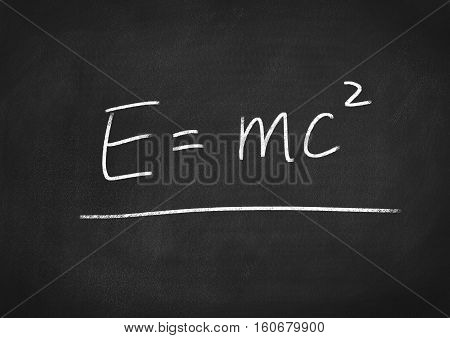 Einstein formula E=mc2 on blackboard chalkboard background