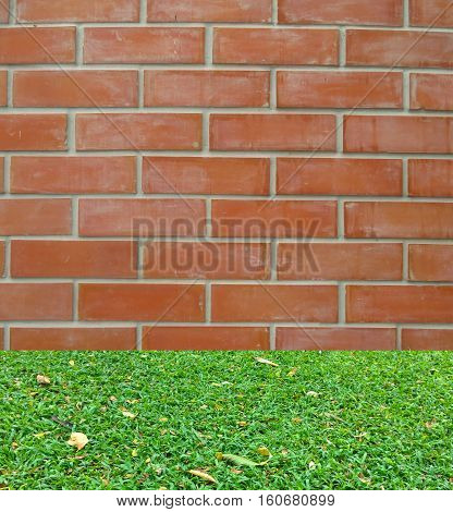 background of brick stone wall and grass floor texture photo