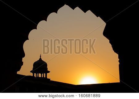 Silhouette of the walls famous red fort tower dome Agra Fort in Uttar Predesh India.