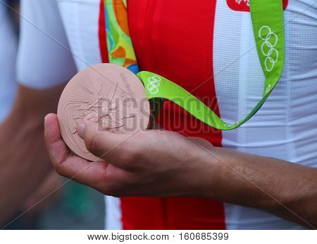 RIO DE JANEIRO, BRAZIL - AUGUST 6, 2016: Bronze medalist Rafal Majka of Poland holds Olympic bronze madel after men Cycling Road medal ceremony of the Rio 2016 Olympic Games