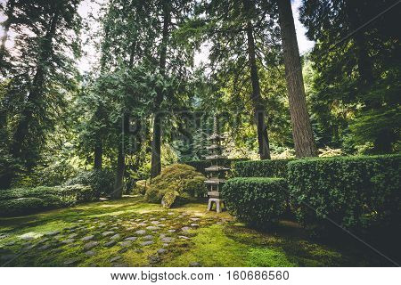 Trees and garden structure in beautiful Japanese Garden setting. Portland, Oregon, USA.