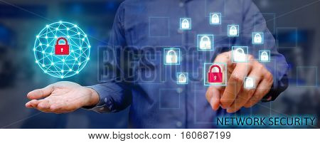 Cyber security network concept Young asian man holding global network security and pressing lock icon with virtual screen.