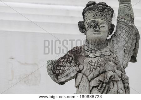 stone statue antique style China Closeup temple in Thailand. with copy space.
