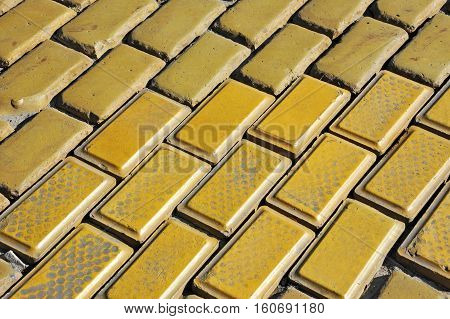 Yellow paving stone background on city street