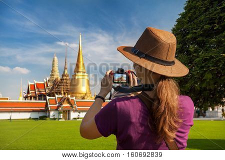 Woman Tourist With Camera In Bangkok