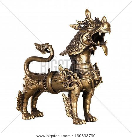 The growling snow lion - the figurine made of bronze in traditional Chinese style isolated on a white background.