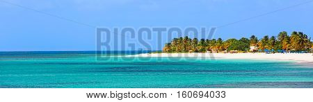panorama of beautiful caribbean island with turquoise lagoon palm trees and white sand beach at anguilla island