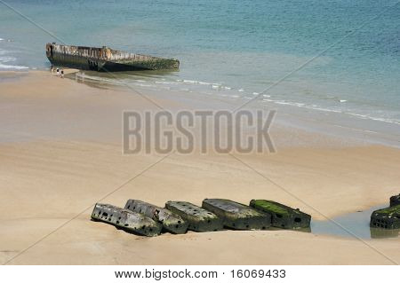 View on Mulberry harbour at Arromanches, Normandy, France, with the remains of the artificial harbour, used on D-Day in World War II
