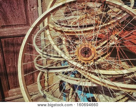 Old rusty bicycle wheels/ Retro color filter and Close up (bicycle, wheel, vintage)