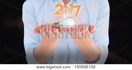 Womans hands presenting against dark background