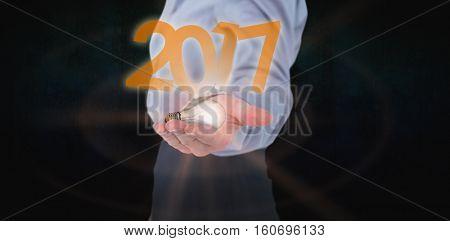 Businesswoman presenting with hand against dark background