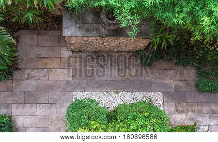 Natural flagstone path landscaping in home garden. Top view