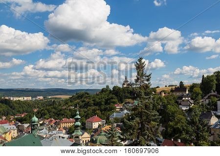 Ancient city Banska Stiavnica Slovakia UNESCO World Heritage site. Panorama of town on the background of cloudy blue sky. Top view.