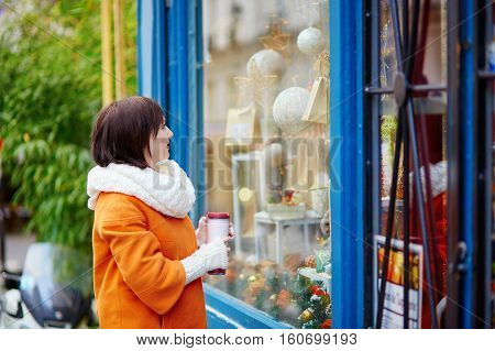 Girl Looking At Parisian Shop-windows Decorated For Christmas