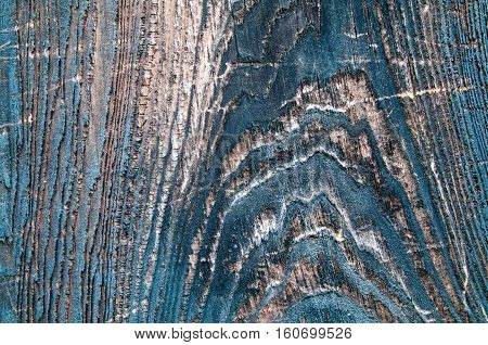 Large macro closeup of a very old knot in weathered aged wood